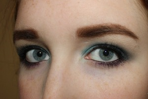 The open eye shot for my teal smokey eye. I used Maybelline Color Tattoo in Tenacious Teal as a base and layered blues and blacks to create this look.