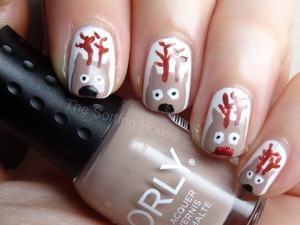 More info on the blog - http://thesortinghouse.co.uk/nails/12-days-christmas-manis-reindeer-nail-art/