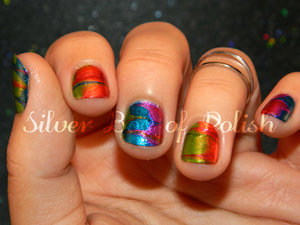 Dry marbled, rainbow colored nails.