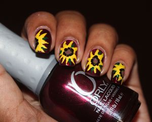 My version of SunFlowers http://www.bellezzabee.com/2012/09/nail-challenge-day-14-sunflowers.html