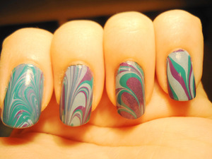 """marbling- i wanted to try diff. """"patterns"""" on each nail due to curiosity ^^- the colors are pretty ugly though :/"""