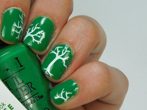 OPI Sandy Hook Green with tree branches stamped using Winstonia stamping plate. For more info please visit my blog post:  http://www.lacquermesilly.com/2014/02/08/stamping-saturday/
