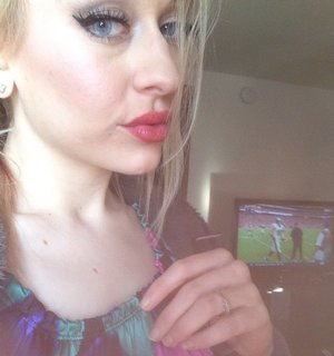 Red lips and photo bombed by Sunday Football 🏉