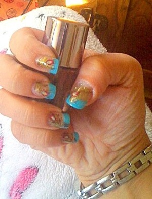 My first attempt at peacock feather nails, not as hard as I thought. If you have the basic colors you can achieve this! Sorry about the crappy quality picture, I don't have the best camera on the block...