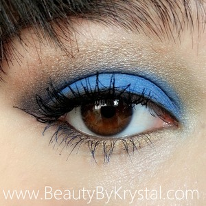 Affordable eye look, party friendly, bright and smoky. http://www.beautybykrystal.com/2013/11/blue-gold-party-eye-look-with-elf.html