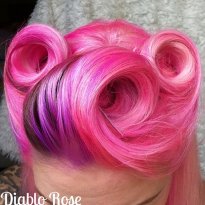 Pink and lilac vintage victory rolls