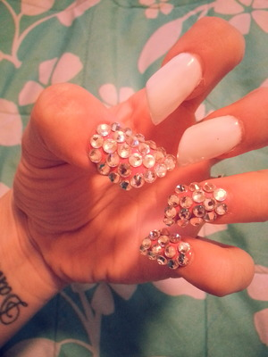 white and pink polished on acrylic nails w/ swarovski gems on top of pink