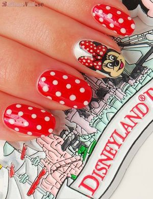 """For this """"Minnie""""-cure I used OPI The Color of Minnie as a base, China Glaze White Out for dots & Minnie is free-hand painted with acrylic paints.                              http://brilliantnail.se/nagel-blogg"""