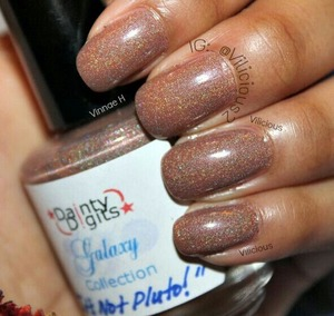 Two coats of Dainty Digits It's Not Pluto! without topcoat. A nude cocoa brown holographic!