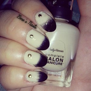 A beige base with a black gradient at the tips. Accented all the nails with a round gold stud.