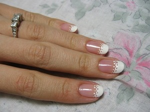 This isn't mine, I found it on google. But it's so adorable and reminds me of lace. It's a delicate, feminine mani that is really cute for summer