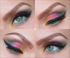 1. Prime the eyelids with Urban Decay's primer potion and apply a bit of NYX jumbo eye pencil in MILK over the mobile eyelids.  2. In the inner corner apply a yellow gold eyeshadow followed by a gold bronze eyeshadow.  3. Over the middle eyelid apply a red eyeshadow.  4. Highlight under the eyebrows with a white eyeshadow and blend in a matte light brown eyeshadow over the crease as a transition color.  5. In the outer V apply a green eyeshadow and blend it up in the outer crease.  6. Under the eye apply NYX jumbo eye pencil, apply it also in the waterline. Over it apply a light green eyeshadow.  7. Apply a black cake eyeliner and make a wing.  8. Apply mascara and put on false eyelashes. You're ready fot the Christmas celebrations! :)