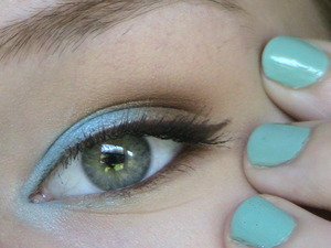 """I was playing around with makeup one day and came up with this look! It's a neutral look with a bright aqua color in the inner third and inner corner of my eye. I think it's super pretty and it kind of went with my nail polish which is Sinful Colors """"Open Seas"""" I hope you all like it!"""