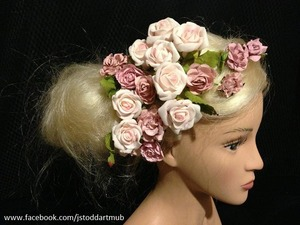 I'm new to hairstyling. These are my practice pictures on my trusty hairstyling doll head. This is a possible look for an upcoming photo shoot.