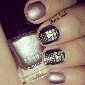 Bronze and black base nails. Cut up some nail wraps and accented the black nails to give the illusion that they are studded.