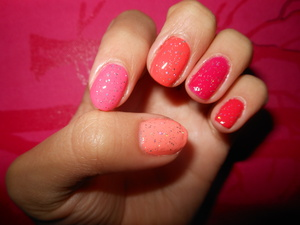 I have a photo up of a summer nail set by e.l.f, it contains four colors. Starting from the thumb, to the pinky, the fourth finger is not elf, because it only had 4 colors, it is Love and Beauty by f21, in Fuchsia. On top is Wet n Wild Kaleidoscope glitter.