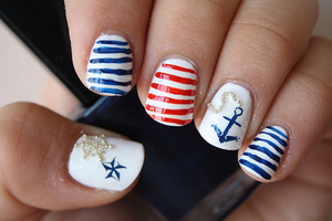 White base. Stripes done with acrylic paints.