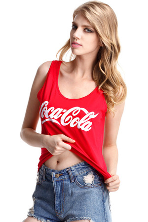"Red sleeveless shirt, featuring round neckline, sleeveless, contrasting ""Coca Cola"" print on chest, loose styling."