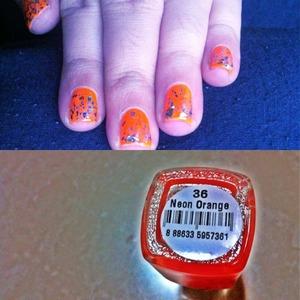 Neon orange and specks of glitters