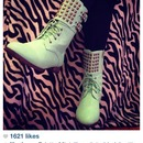 Mint green lace-up boots with flat triangle studs