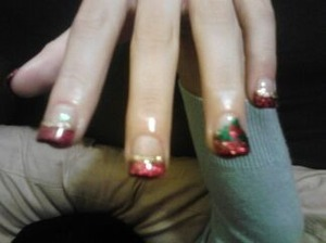 acrylic nails with red and gold tip. Mistletoe design on ring finger