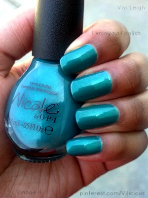 A turquoise/aqua matte with silver shimmer. ♥