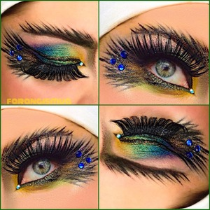 I really like peacock feathers so it inspired me to create this colorful look using morphebrushes palette in b35. I also added bh cosmetics glitters over top to make it more dazzle and dramatic. its very important to draw the feathers, find the best tool to get the perfect feathers. i used supper skinny marker from NYX, even tho it is not waterproof, the application makes it so much easier. to have a waterproof eyeliner stick I recommend using stilla. Remstones or gemstones would be perfect to place just in the inner and outer  corner. have fun try it for yourself.