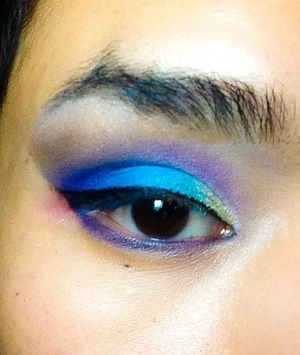 Fun and colorful look with bright blues and purples with a simple cat eye. NYX Jumbo Eye Pencil: Milk as base. And please excuse my brows, just wanted to do a fun quick eye look before bed last night lol.