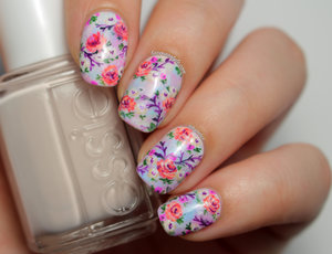 Hand painted with nail polish only.  For more details and photos, visit: http://www.lacquerstyle.com/2014/08/summer-pastel-floral-nails.html