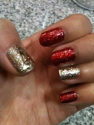 Holiday nails! essie's forever yummy w/ milani one coat glitter in red, and opi glitzerland w/ color club holographic gold and milani gems in gold.