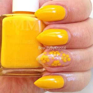 A creamy buttercup yellow MORE PHOTOS: http://www.beautybykrystal.com/2013/06/color-me-monthly-june-humblebee.html Subscription is $7/mon, one polish per month and FREE shipping!