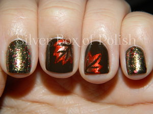 Nail art inspired by Fall. Free handed leaves and glitter in an Autumnal color scheme.