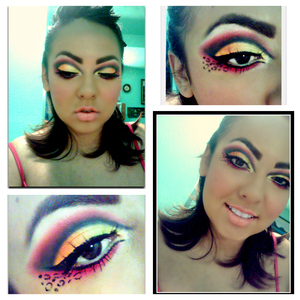 A Cut Crease with yellow orange red and pink. With leopard print.  Make sure to check out Glama Girls Cosmetics the have some AWESOME products!!!  http://www.glamagirlcosmetics.com