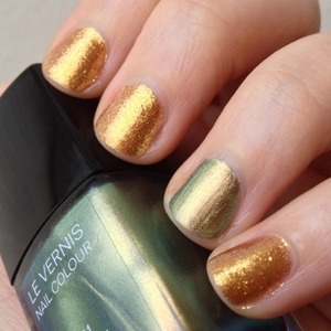 OPI James Bond Skyfall Holiday collection Goldeneye with an accent nail of Chanel's Peridot outside in the shade.