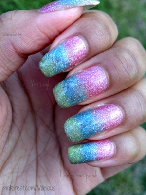 Pink, blue and green holographic gradient.