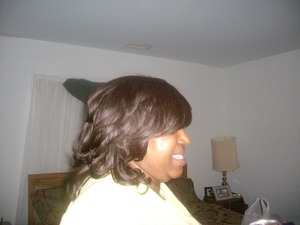 This is the side view of the human hair wig i created for my cousin.