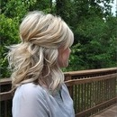 Short half-up hairstyle.