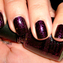 Black with purple glitter nails