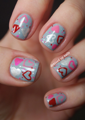 The base is China Glaze Sea Spray and I did the design using nail pens from Nail Candy! More info on the blog post.  http://www.dressedupnails.com/2013/01/early-valentines-day-heart-nail-art.html