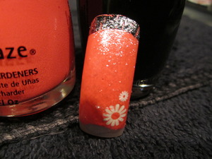 used china glaze nail color, black OPI shatter and then konad stamper for the flower. CND sparkle top coat