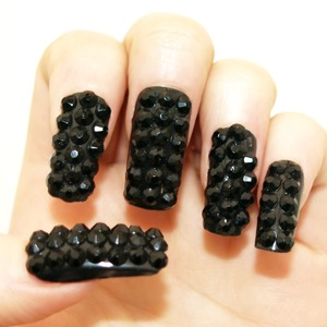 Here is the development of my previously uploaded 'Studded Blackberry Nails' (tutorial here: http://www.youtube.com/watch?v=pq3-L4uo1KI) using extra long fake nails. These are super dramatic and twinkle twice as much as the last ones! Hope you like 'em GFx