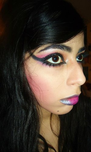The Eyeliner is flared out past the eyebrows for added drama! I contoured with a hot pink blush!