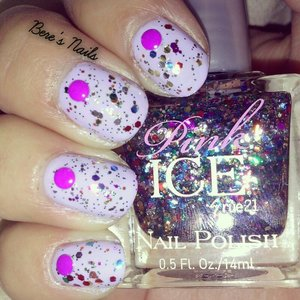 Lavender base topped with a chunky confetti glitter. Accented all the nails with a neon purple round stud.