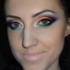 Orange, purple and green cut crease makeup