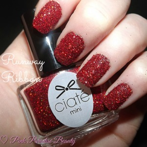 A loose red holographic glitter