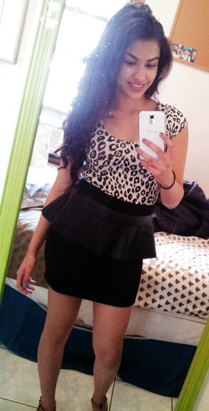 Cheetah print shirt, leather peplum skirt and curled hair :)