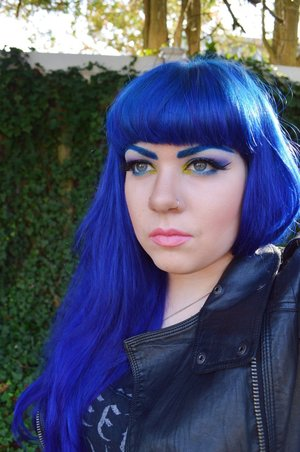"""Hair extensions are from VP Fashion.  Hair color is """"Electric Blue"""" by Special Effects. Base for eyebrows is Em Cosmetics eyeliner in """"Turquoise"""".  Eyeshadow is Urban Decay Electric Palette.  Lashes are Urban Decay Perversion mascara and Perversion Glitter Dip false lashes."""