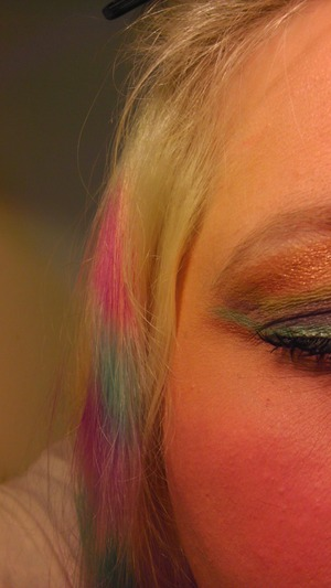 rainbow eye shadow with  colored coon hair..