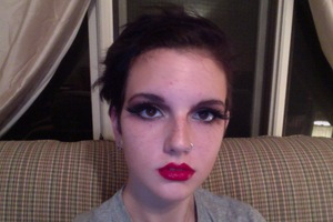 I was going for OTT makeup, but the pictures make it seem rather tame.