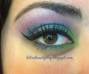 Using my coastal scents 8& palette I chose purple, royal blue, and a light green for a brightly colored peacock themed eye look and to top it all off I used liquid liner for a winged effect